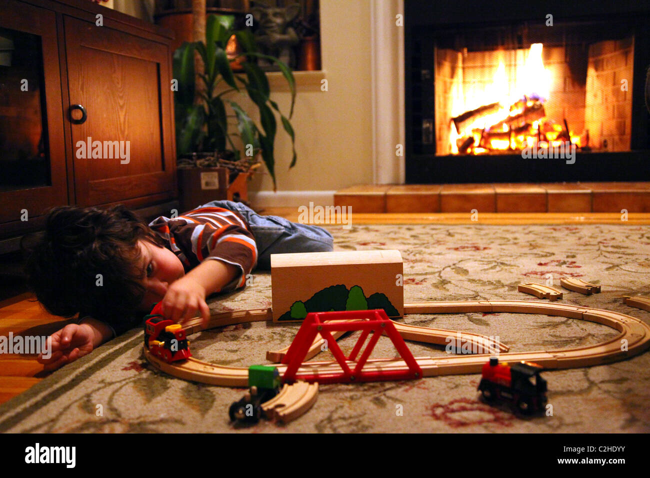 Young boy playing with toy trains Photo Stock