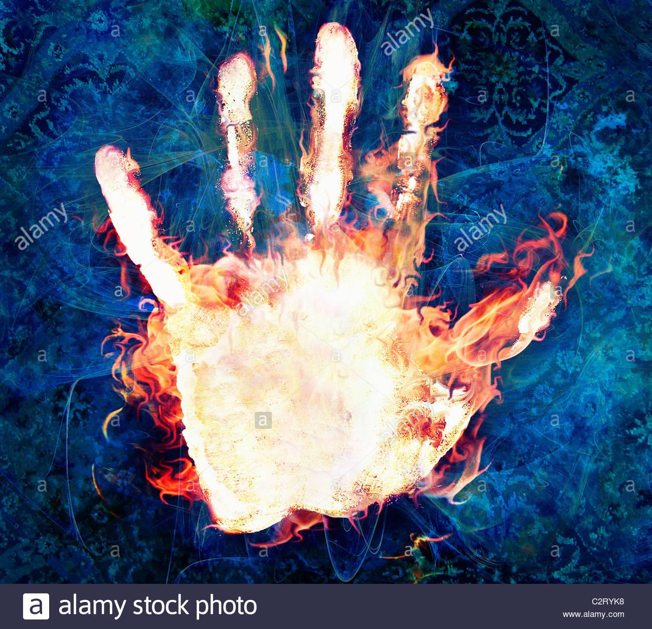 Flammes brûler sur main humaine Photo Stock