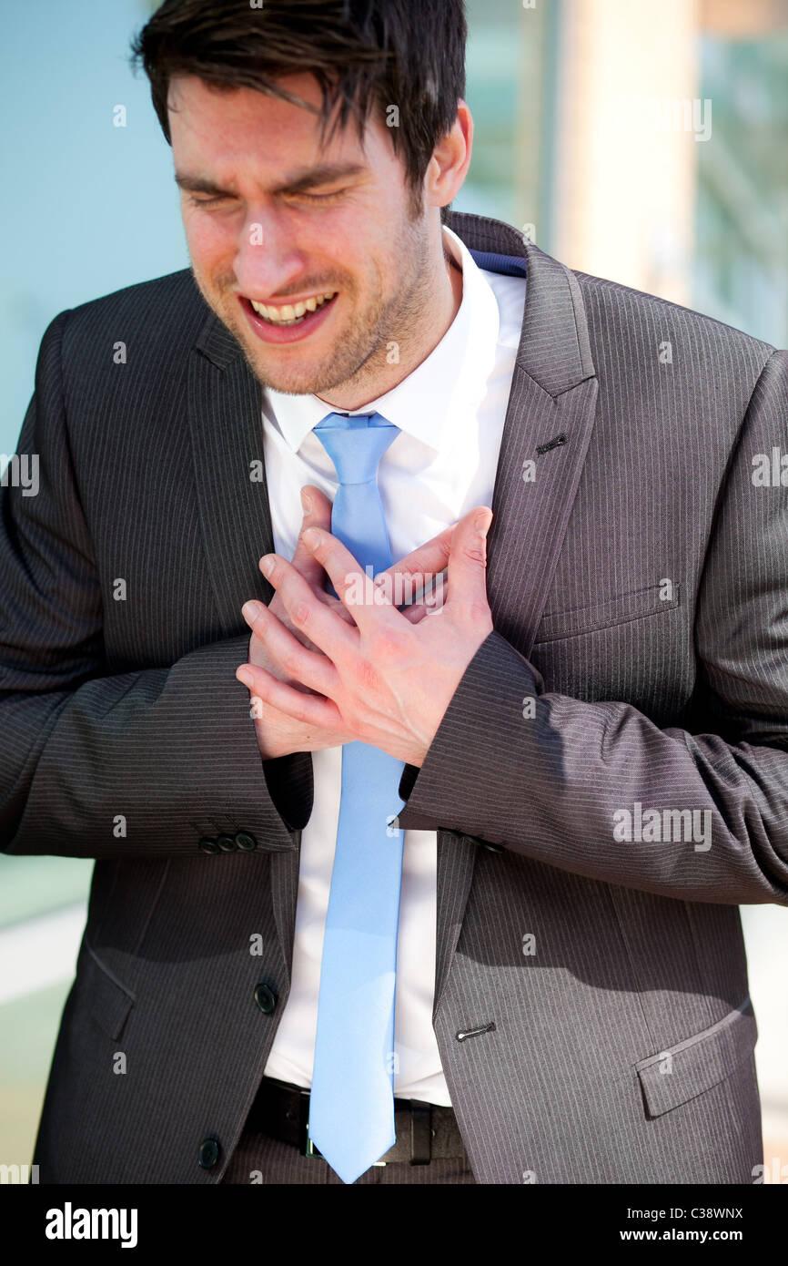 Homme avec douleur à la poitrine Photo Stock
