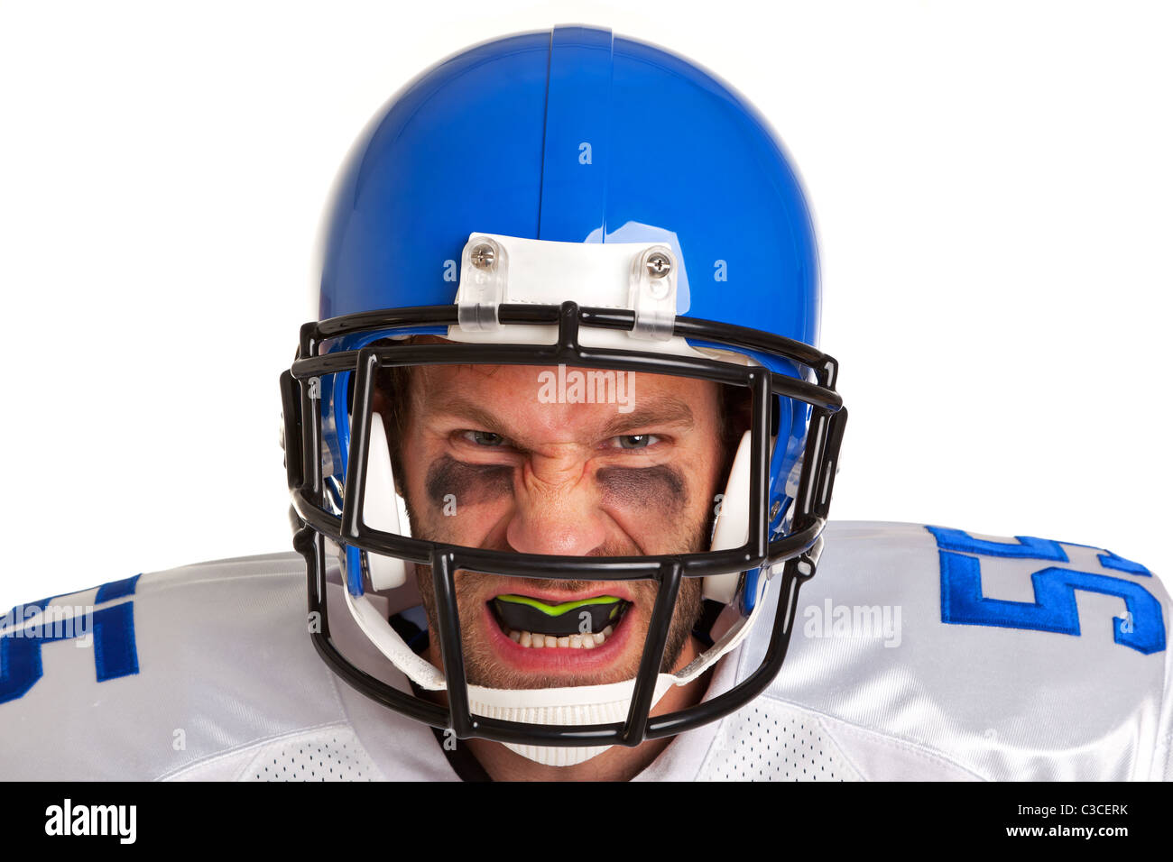 Photo d'un joueur de football américain, découper sur un fond blanc. Photo Stock
