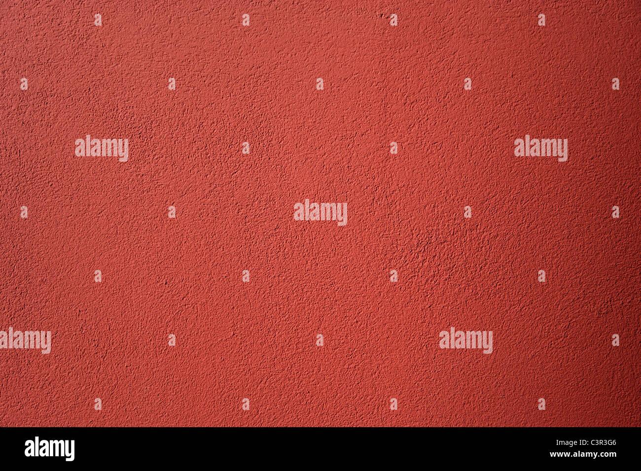 Allemagne, Munich, Close up de plâtre rugueux de chambre peinte en rouge Photo Stock