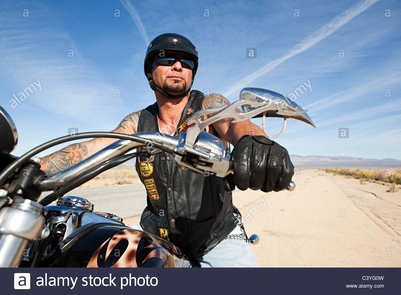 Portrait of mature man on motorcycle Photo Stock