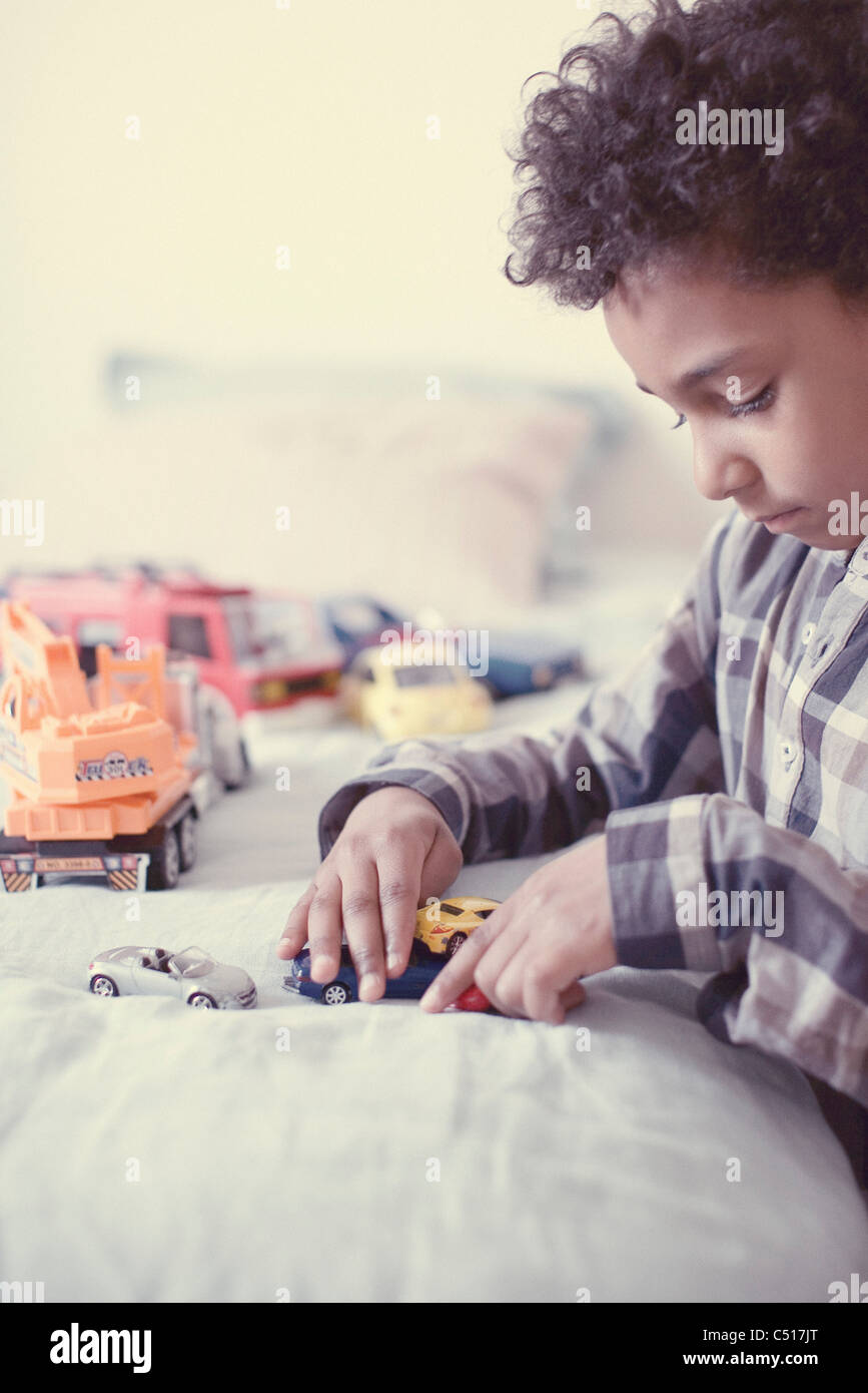 Little boy playing with toy cars Photo Stock