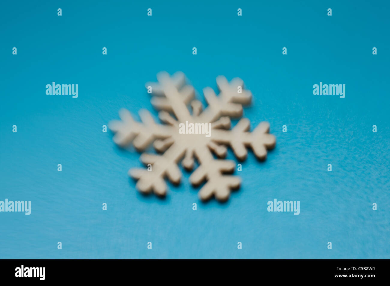 Snowflake ornament on blue background Photo Stock
