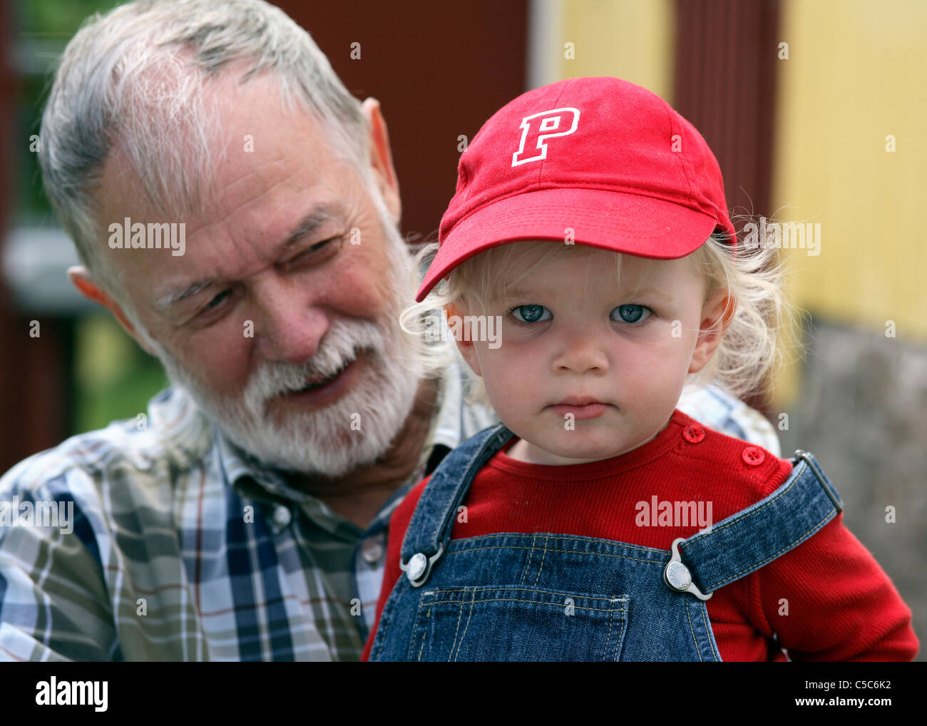 Close-up portrait of a senior man with cute grandkid Photo Stock
