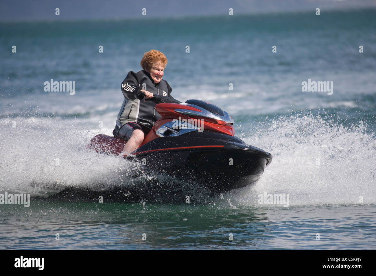 woman jet skiing photos woman jet skiing images alamy. Black Bedroom Furniture Sets. Home Design Ideas