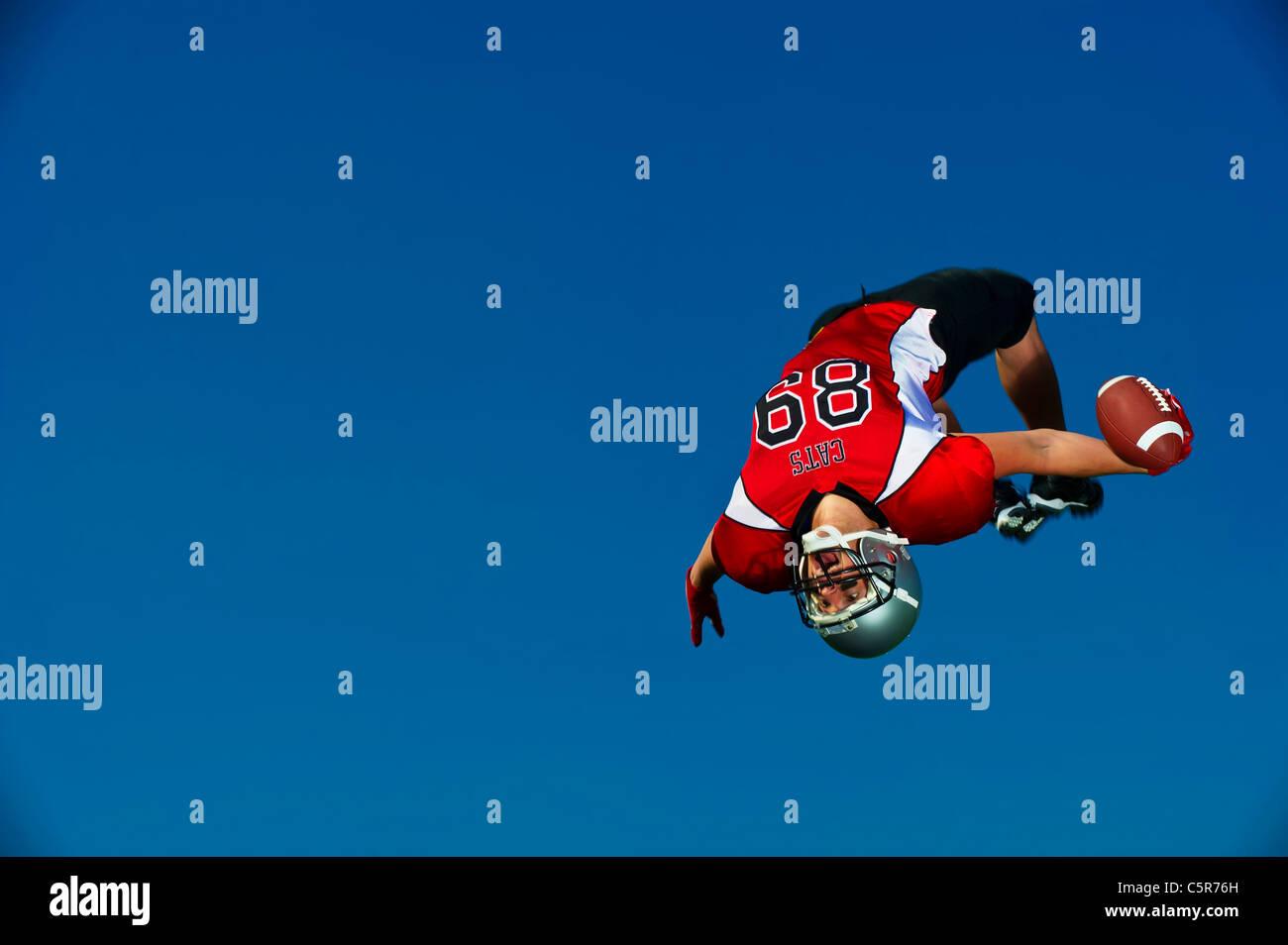 Joueur de football américain célèbre le toucher des roues Photo Stock