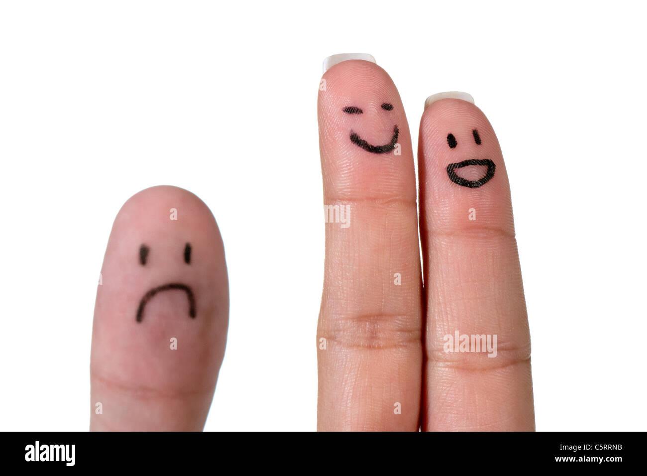 Trois doigts peints comme un couple annonce un regret face Photo Stock