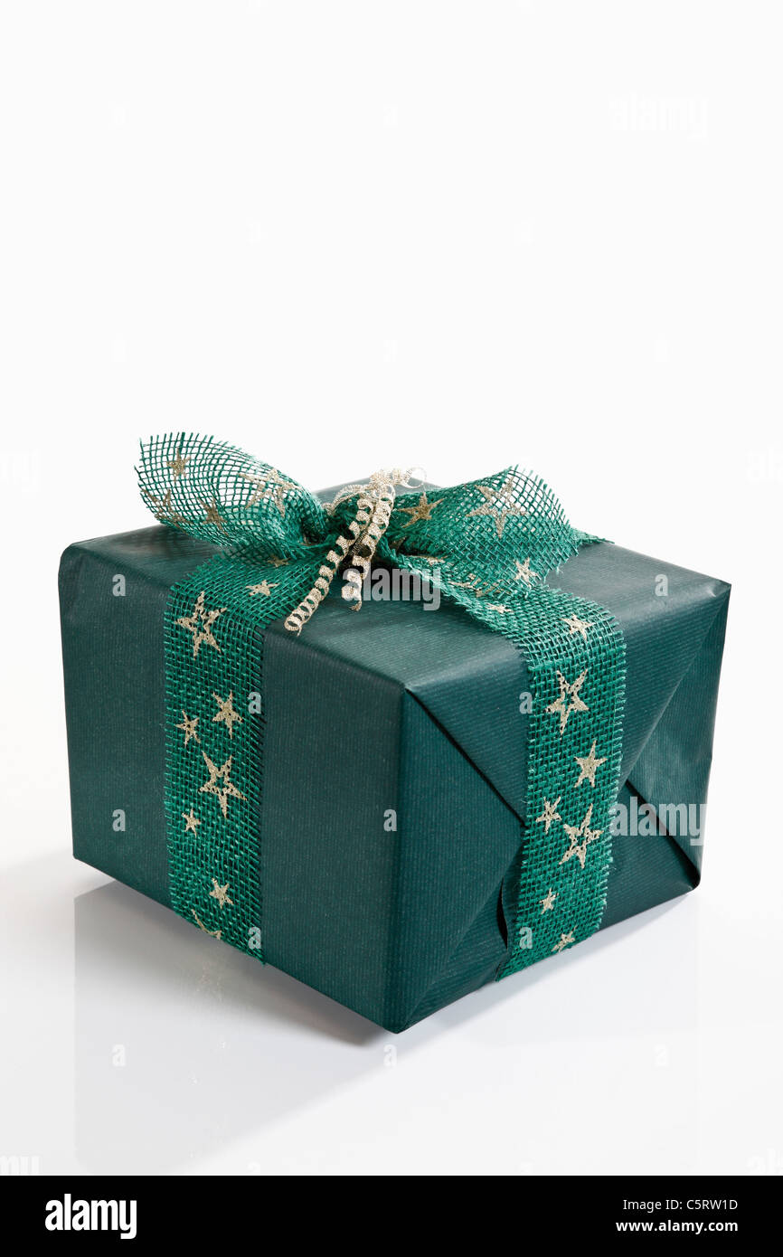 Gift wrapped with green wrapping paper Photo Stock