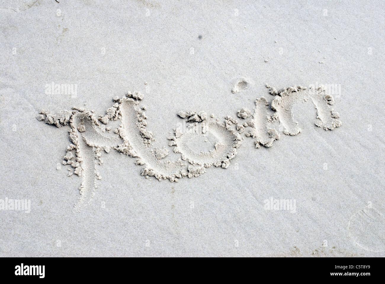 Allemagne, Amrum, le mot Moin écrit dans le sable Photo Stock
