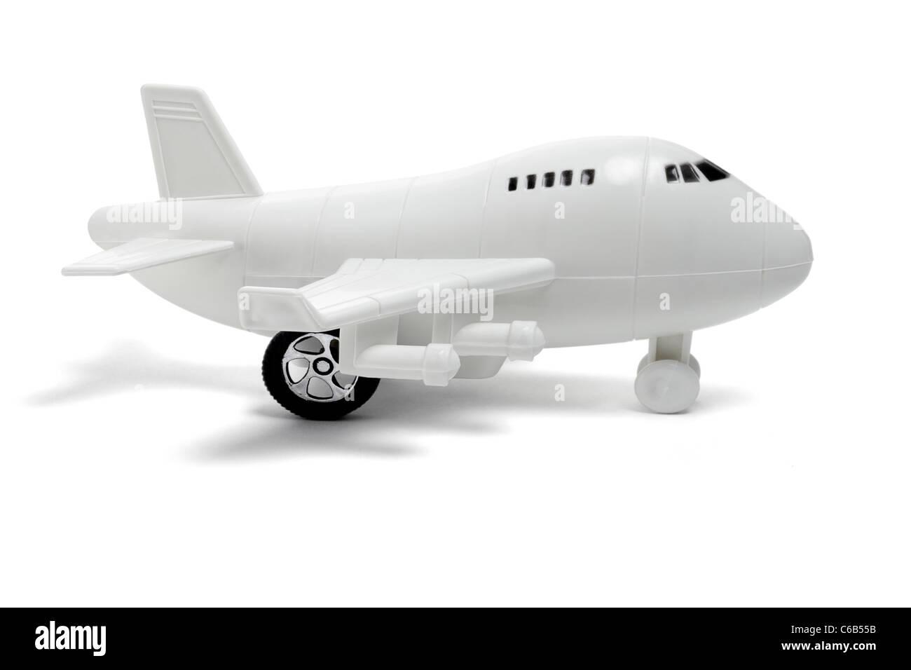 Jouet en plastique passenger jet avion sur fond blanc Photo Stock