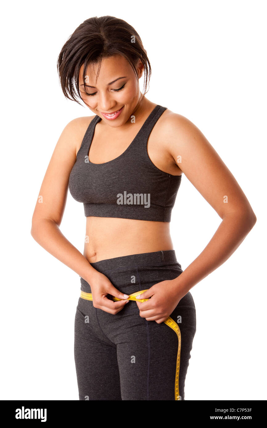 Beautiful happy tonique femme consciente de son poids de mesure taille forme autour de taille hanches habillé Photo Stock