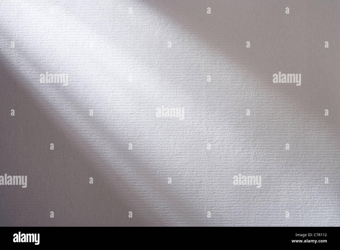 Ombres sur papier blanc texturé. Photo Stock