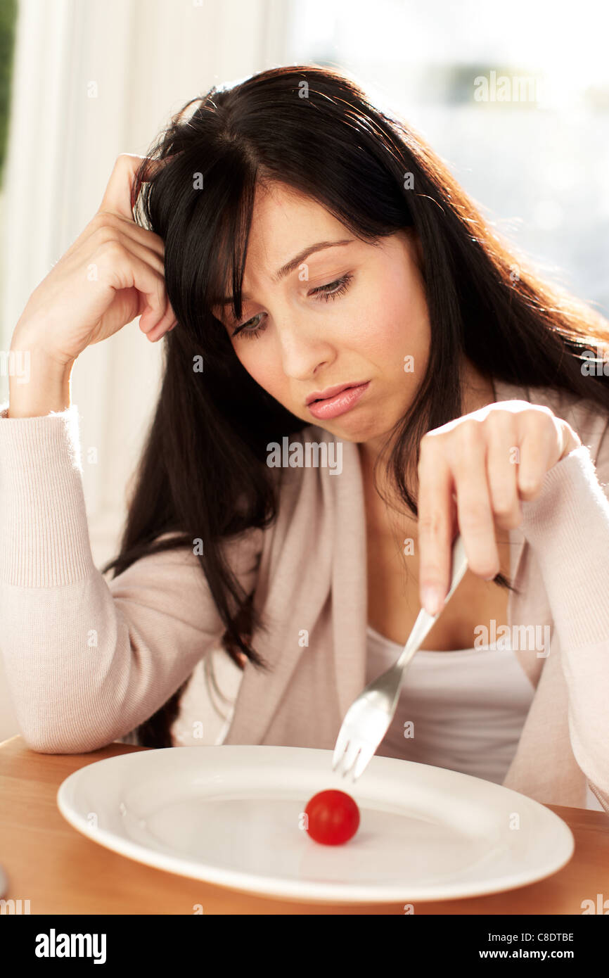 Woman eating tomato Photo Stock