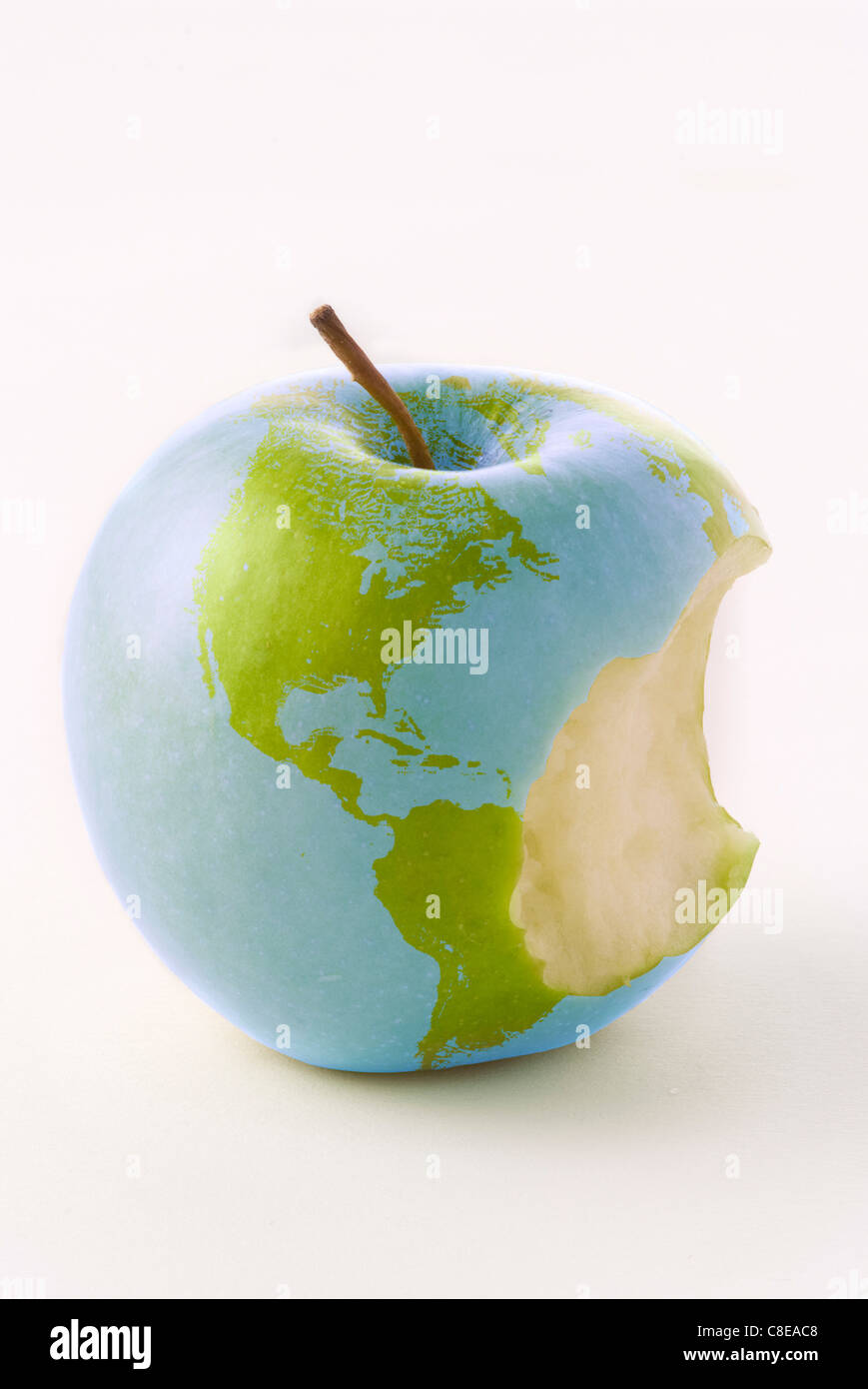 Globe on a mordu apple Photo Stock