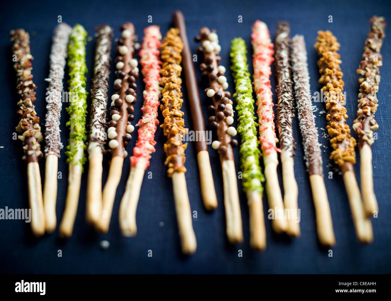 Mikados chocolat aromatisé différents Banque D'Images