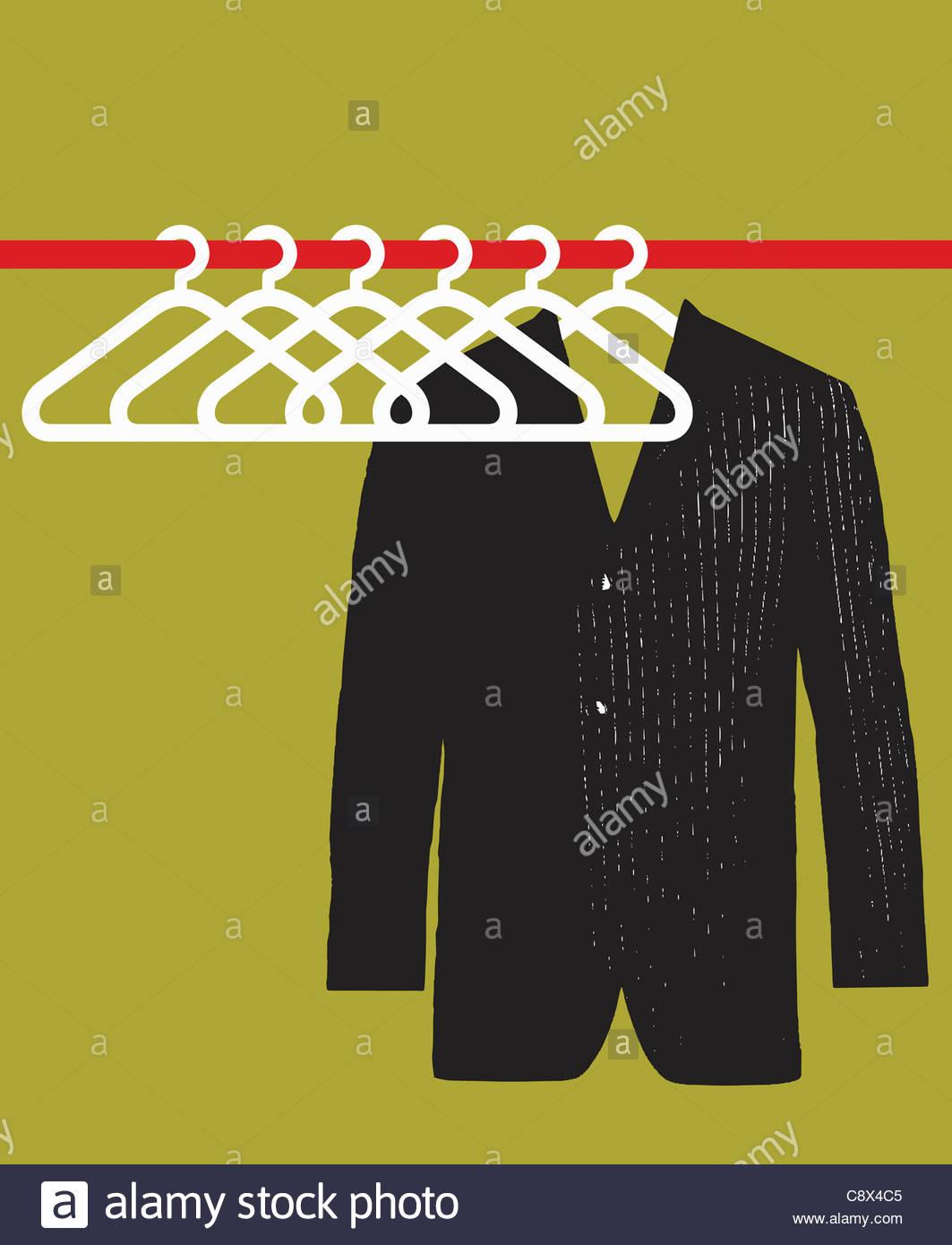 Veste de costume accroché dans vide penderie Photo Stock