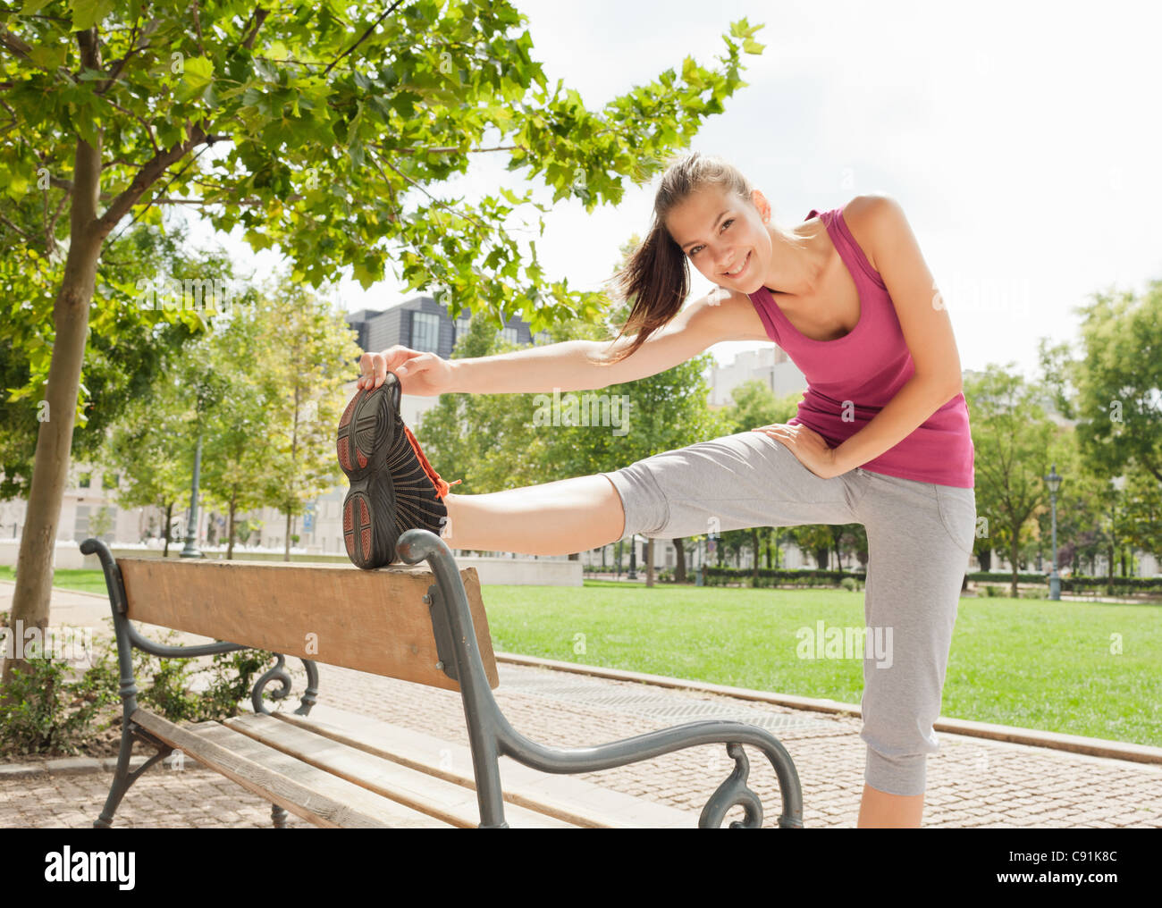 Runner stretching in park Photo Stock