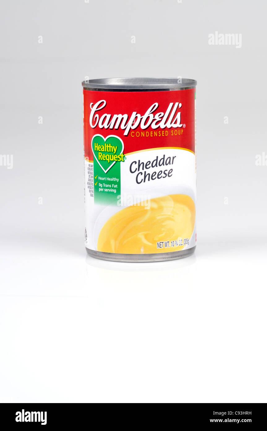 Peut de Campbell's soupe au fromage cheddar sur fond blanc dentelle Photo Stock