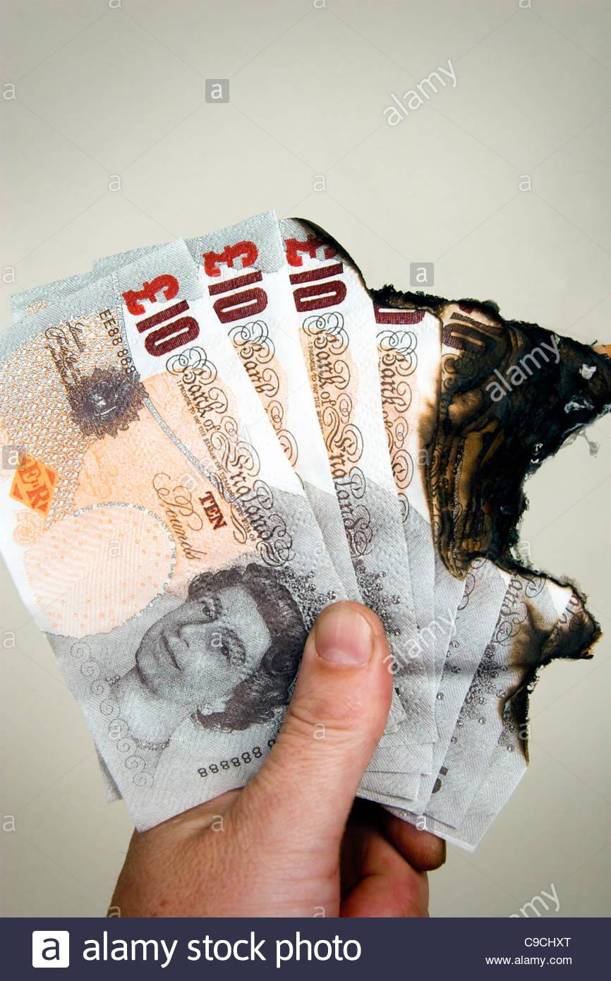 Brûlé £10 notes, la monnaie britannique. Photo Stock