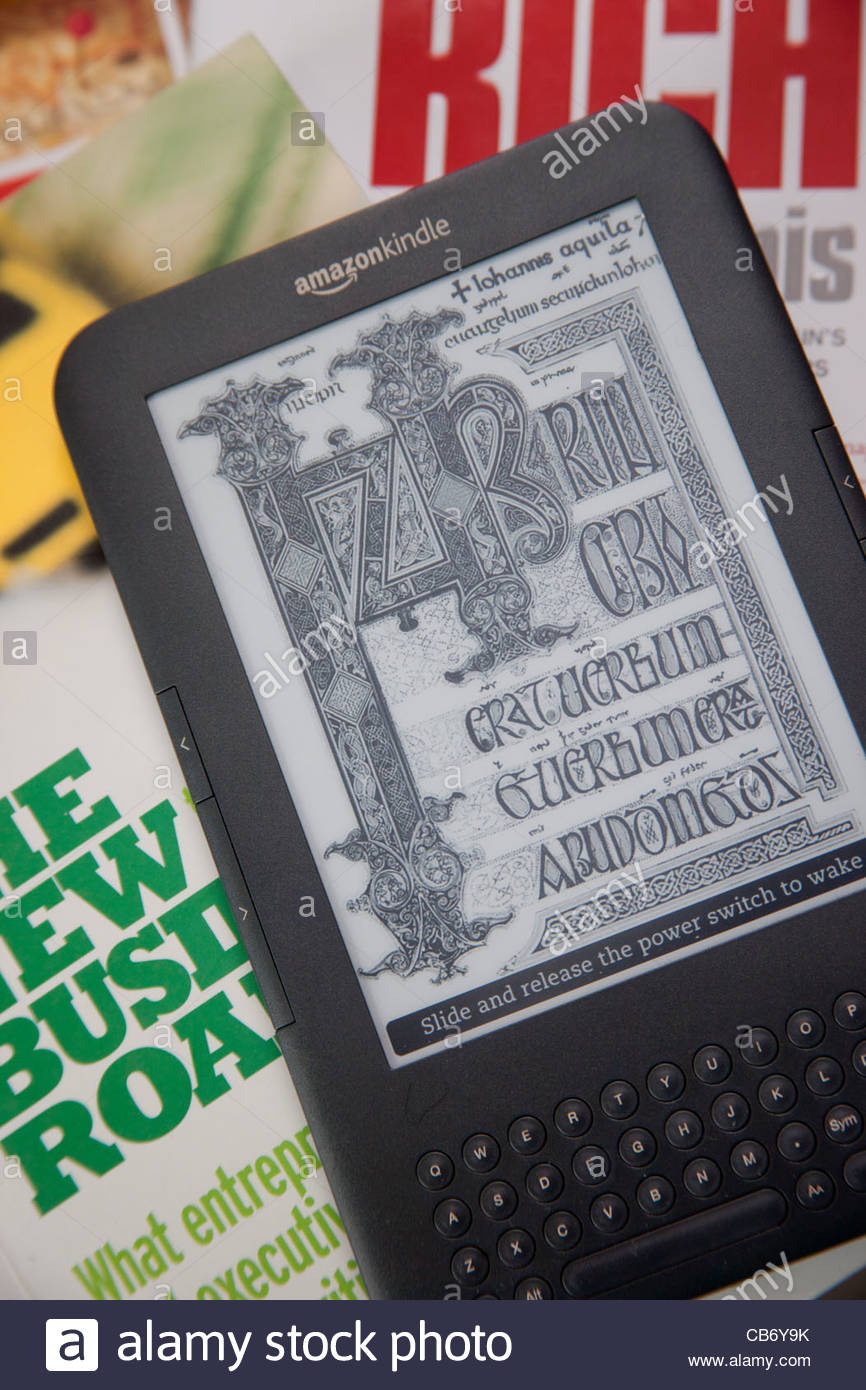 Business Books Kindle e-Reader Tablet Computer Photo Stock