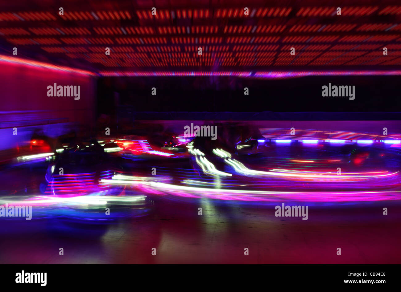 Dodgem cars in motion Banque D'Images