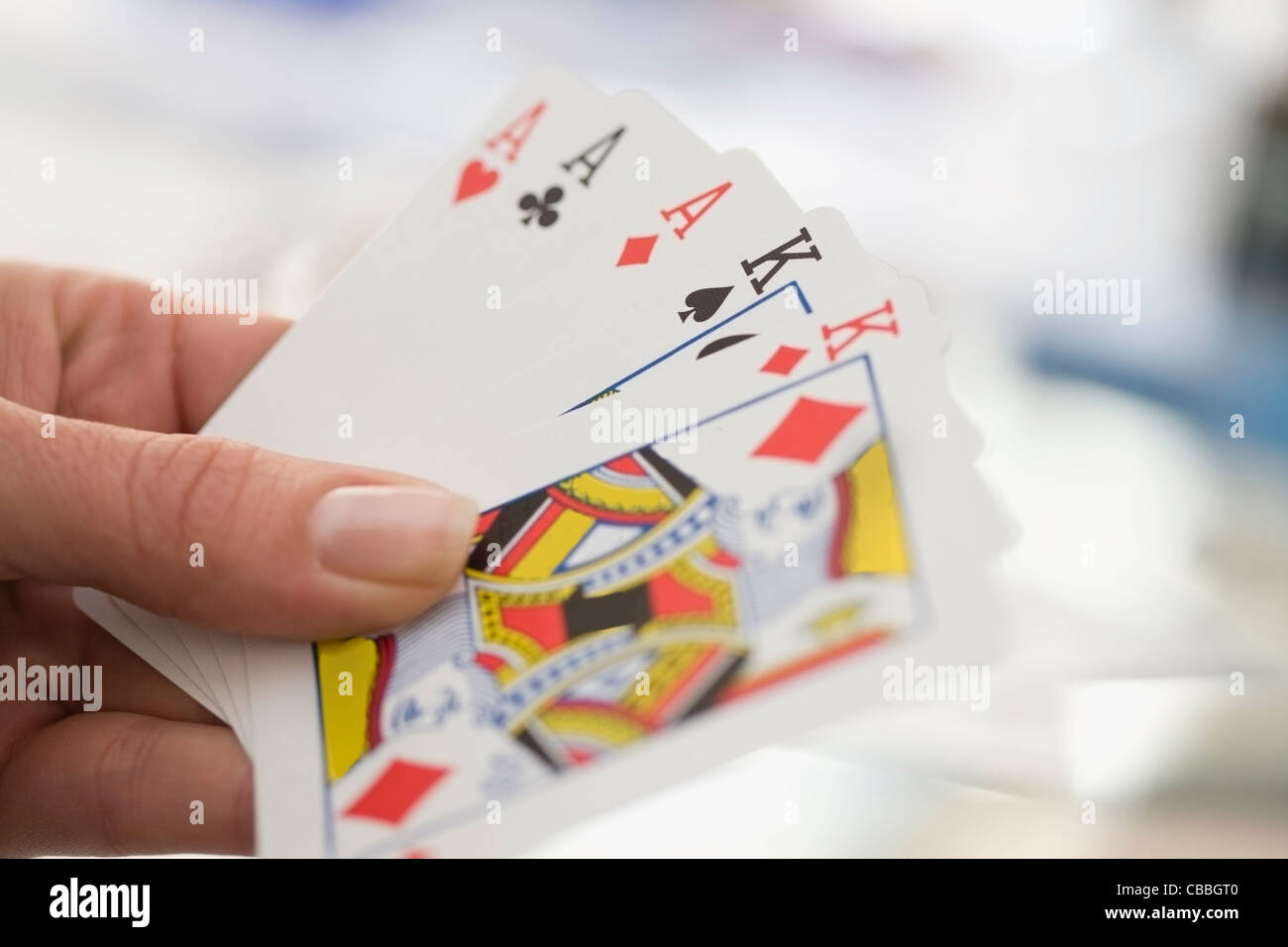 Close up of woman playing cards Photo Stock
