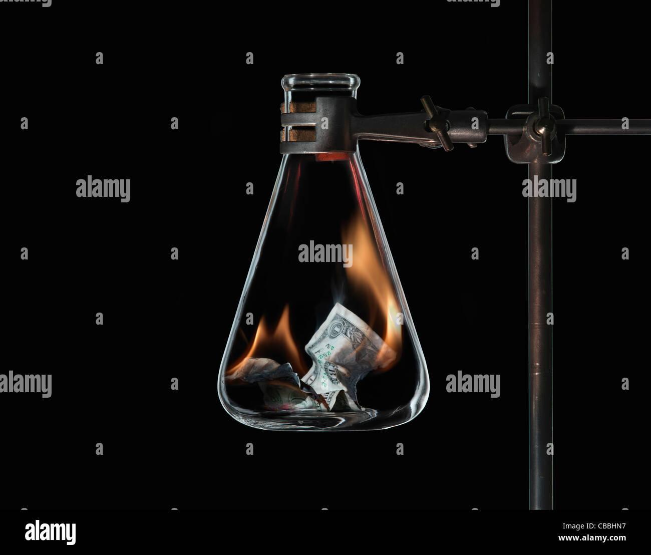 L'argent dans le pot à feu Photo Stock