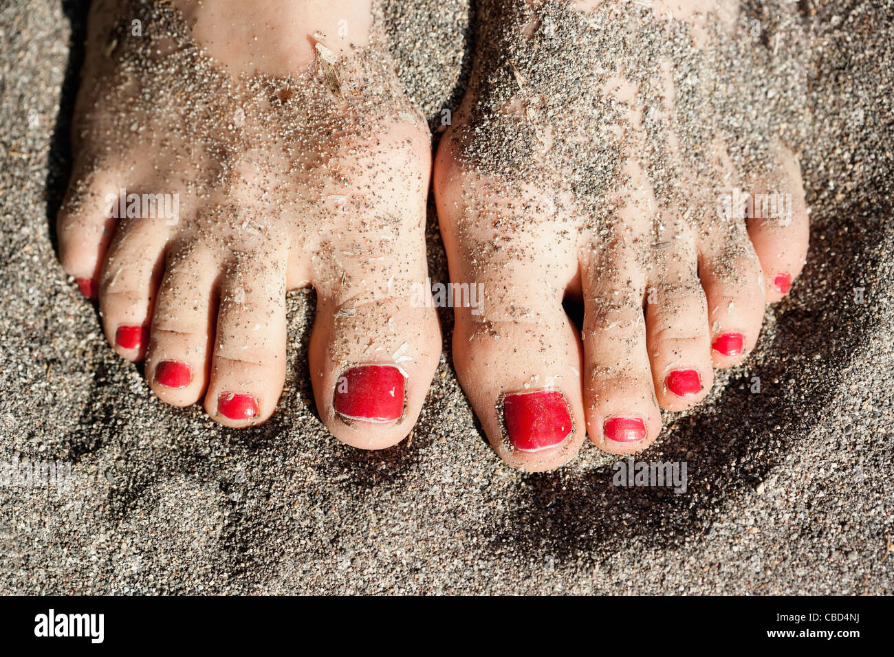 Close up of woman's pieds dans le sable Photo Stock