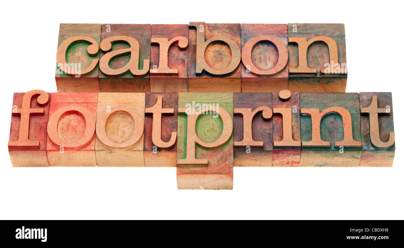 Bilan carbone - mot péché vintage typographie, blocs en bois souillés par les encres de couleur, Photo Stock