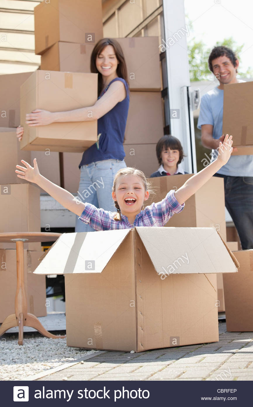 Girl playing in moving box Banque D'Images
