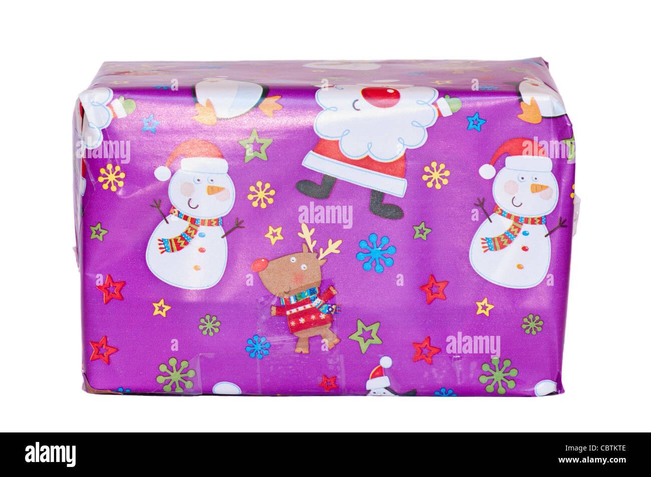 Cadeau de Noël enveloppé dans du papier cadeau de Noël Photo Stock