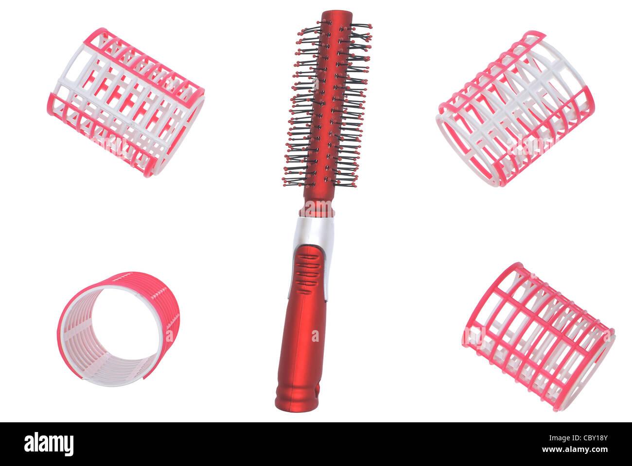 Les bigoudis et brosse à cheveux. Photo Stock