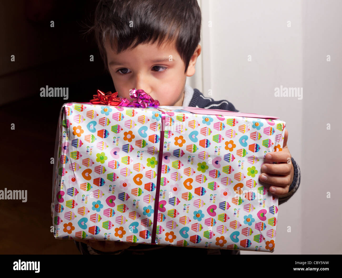 Boy holding a present Photo Stock