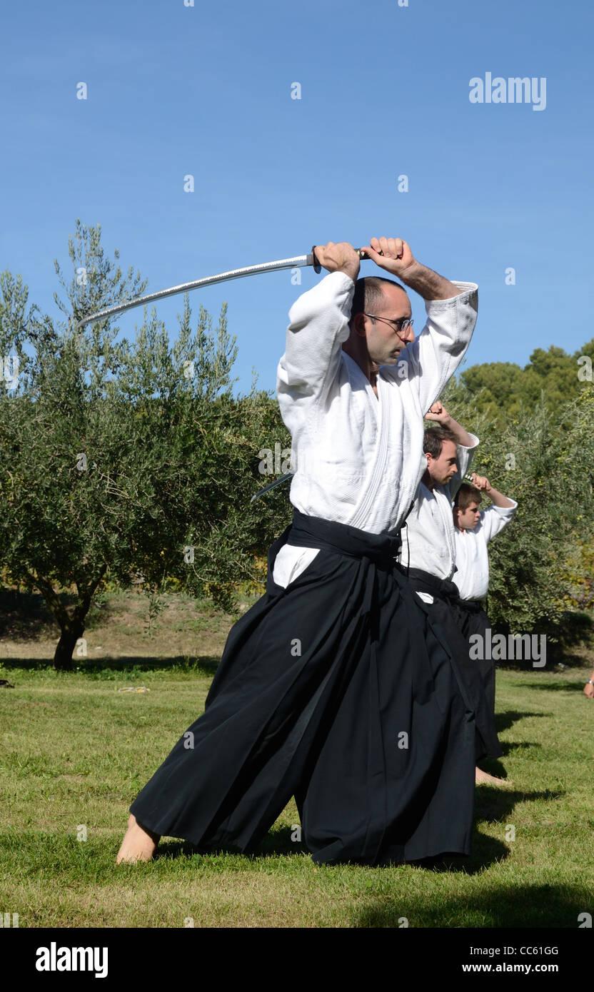 Les praticiens de l'ouest des Arts Martiaux Japonais, combat à l'épée ou sabre, combat, le Photo Stock