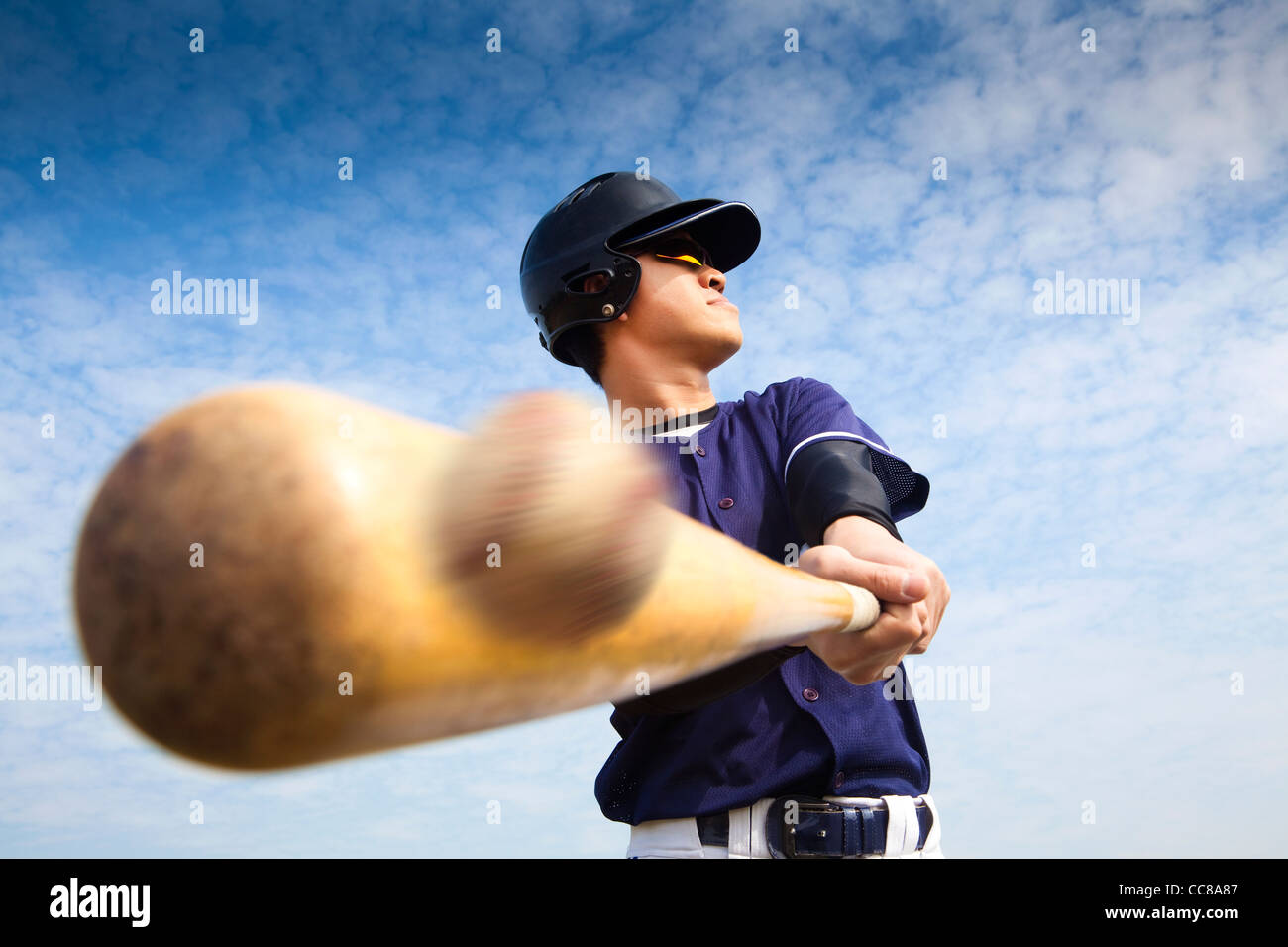Joueur de baseball frapper Photo Stock