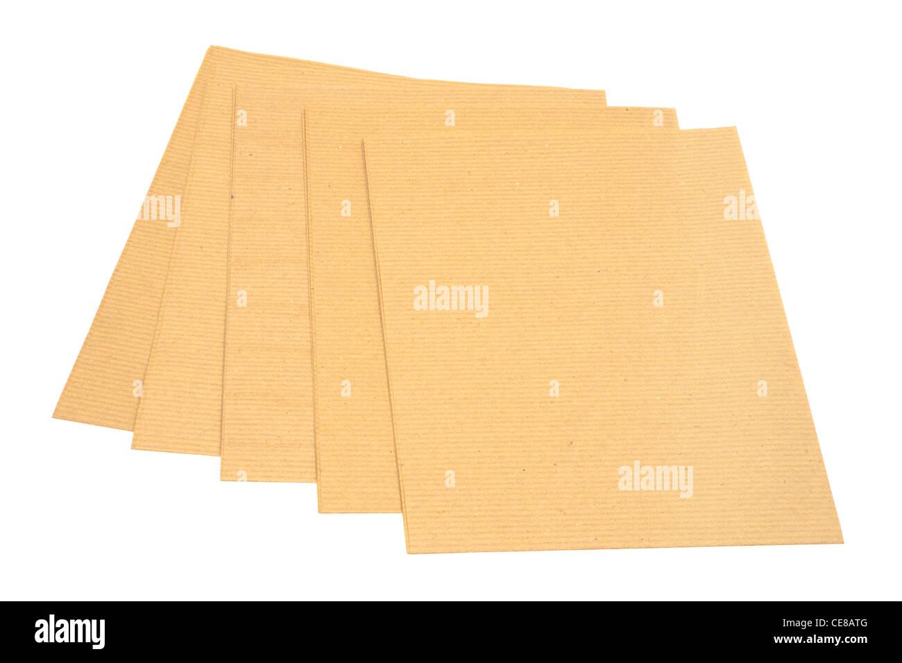 Cinq feuilles de papier d'emballage brun Photo Stock
