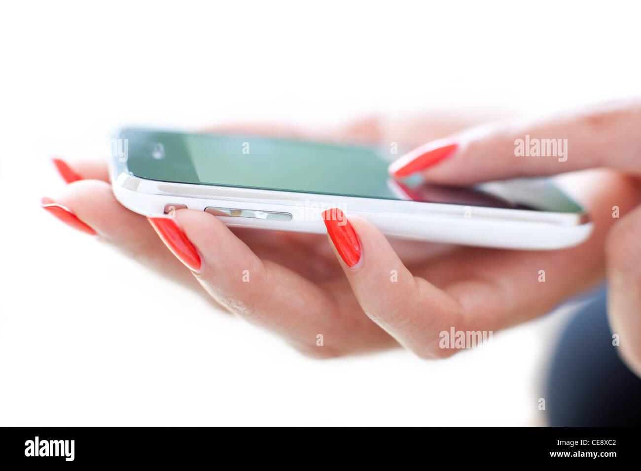 Parution du modèle. L'utilisation du smartphone. Photo Stock