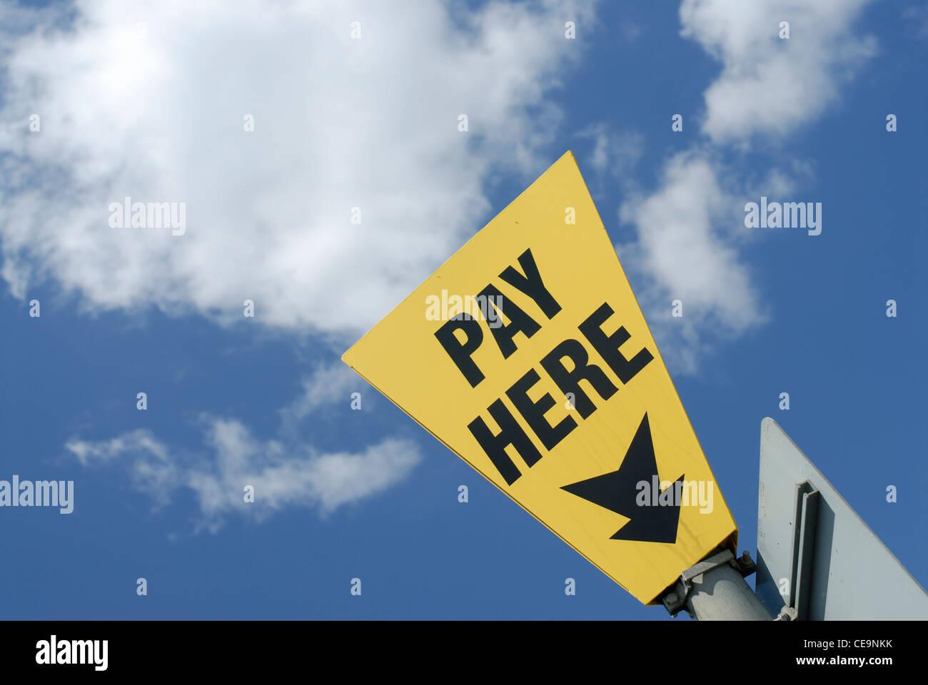 Payez ici signe Photo Stock
