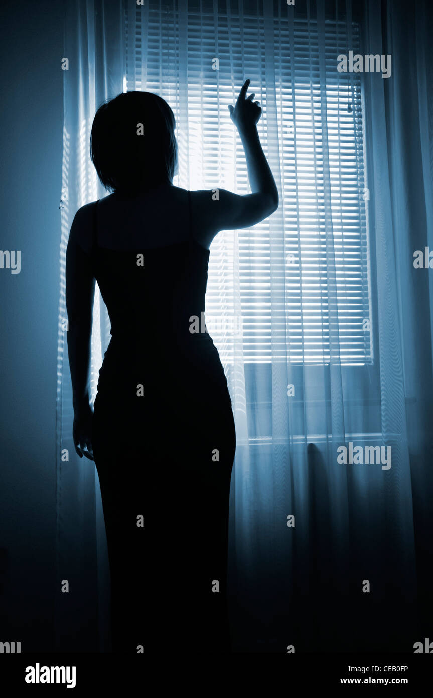 Woman Reaching for light Photo Stock