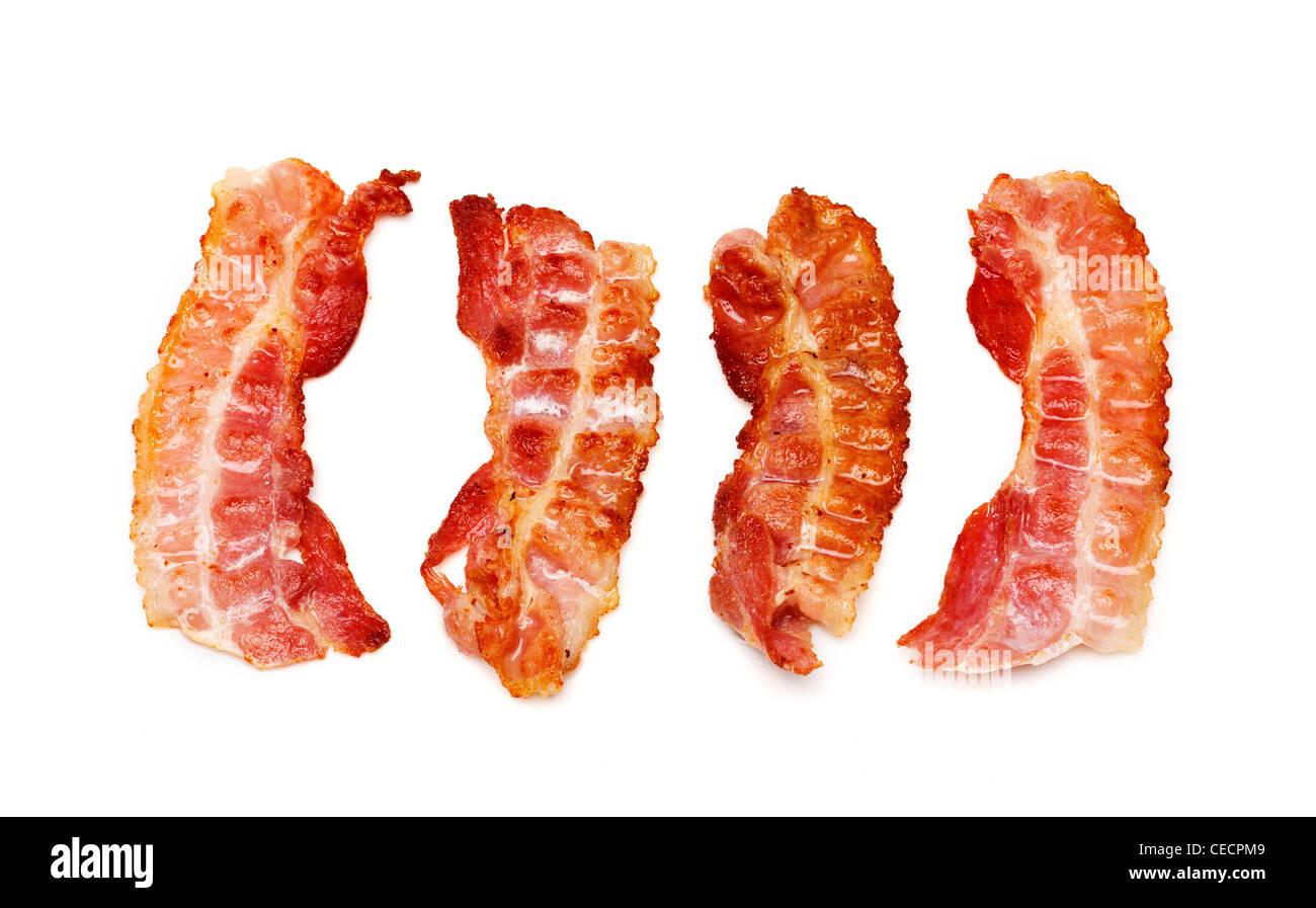 Tranches de bacon sur fond blanc Photo Stock