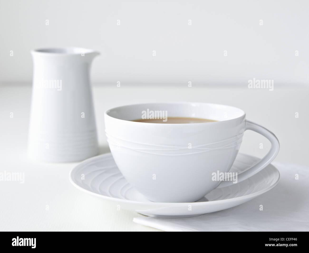 Tasse de thé au lait Photo Stock