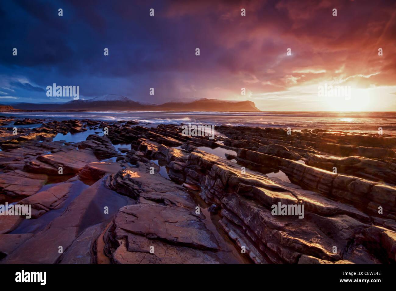 Lumière d'hiver mousseux à Warebeth Beach, Orkney Photo Stock