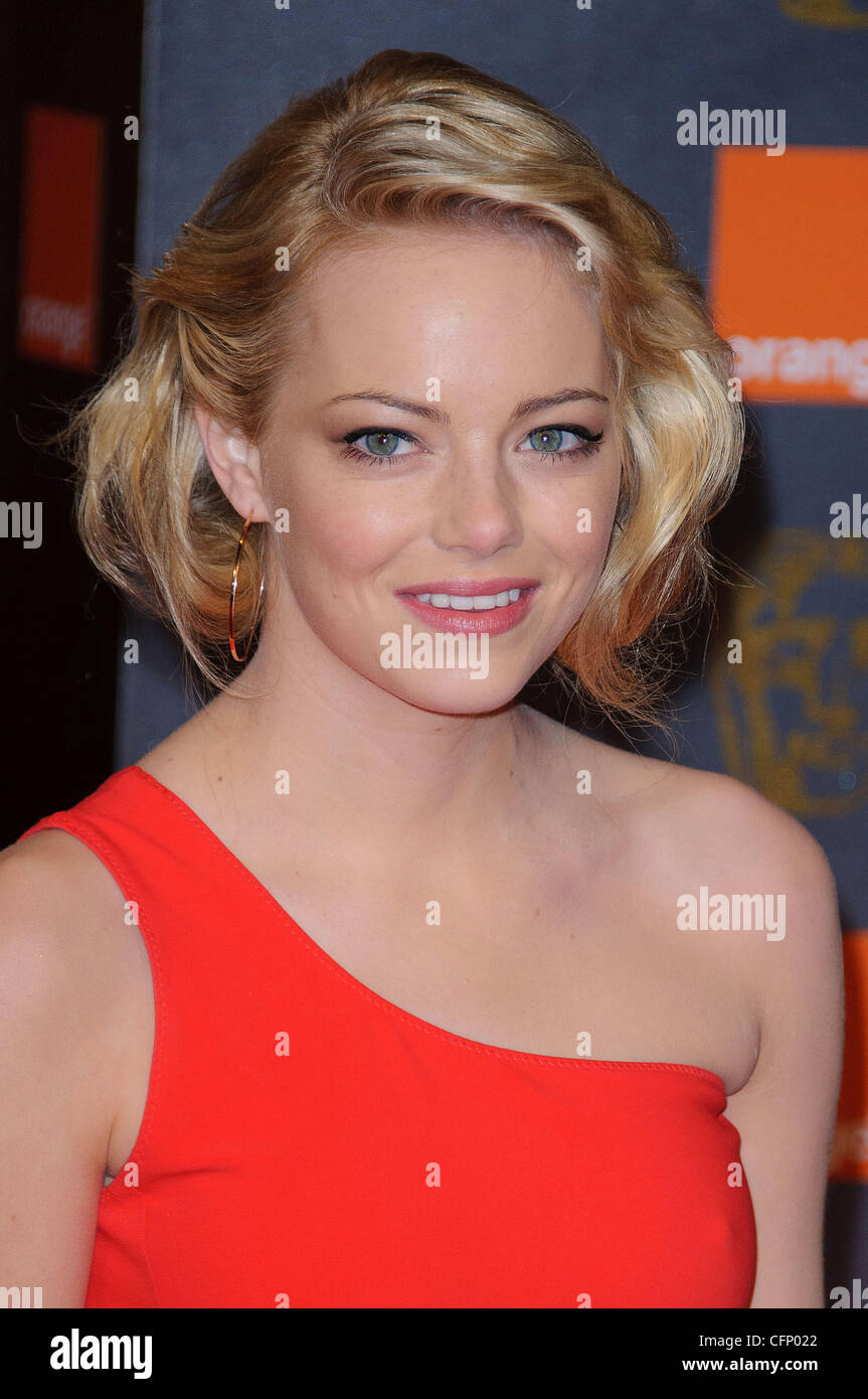 Emma Stone Orange British Academy Film Awards (BAFTAs) s'est tenue au Royal Opera House - Arrivées Londres, Photo Stock