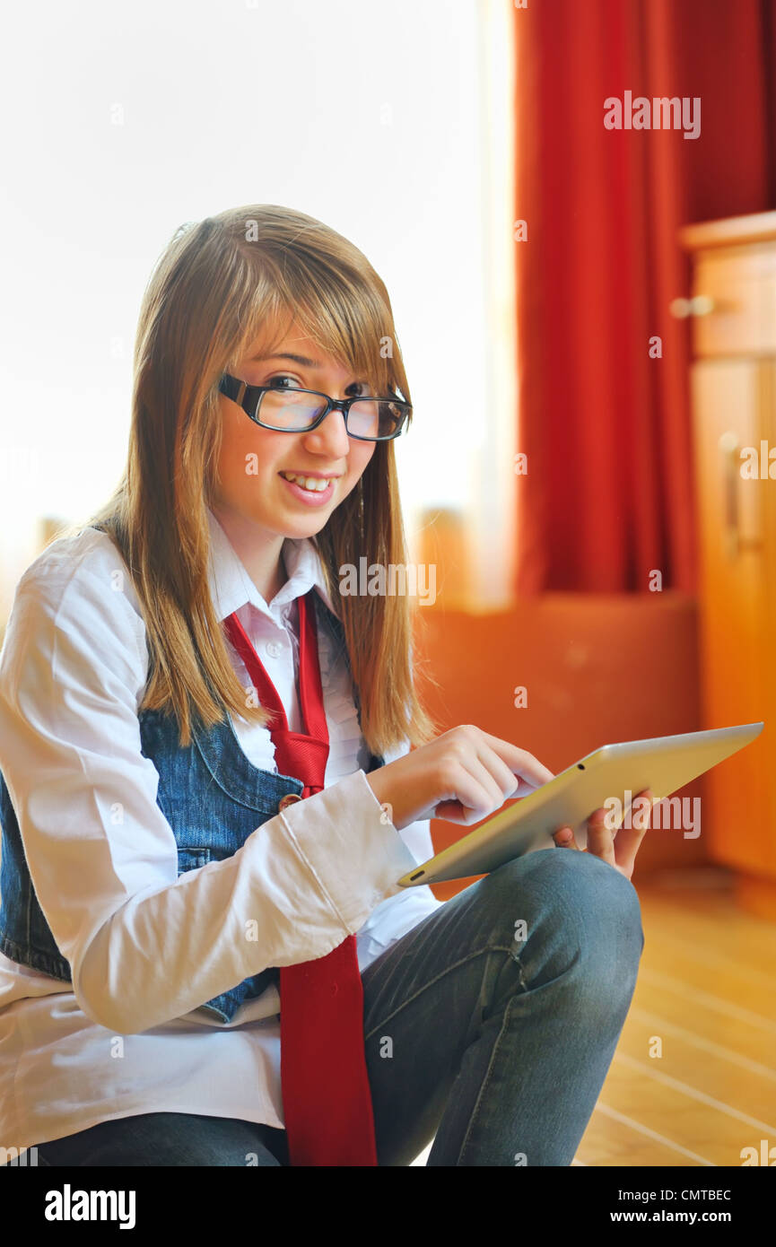 Girl holding a tablet touchpad Photo Stock