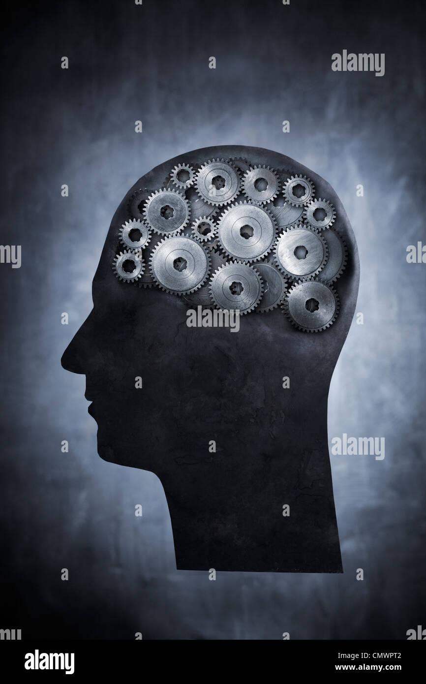 Image conceptuelle de la tête remplie de cog gears. Photo Stock