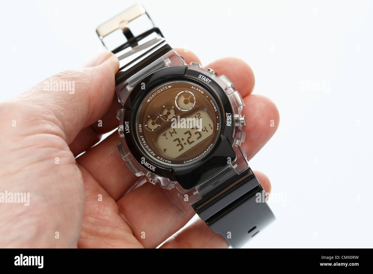 Human hand holding wrist watch, Close up Photo Stock