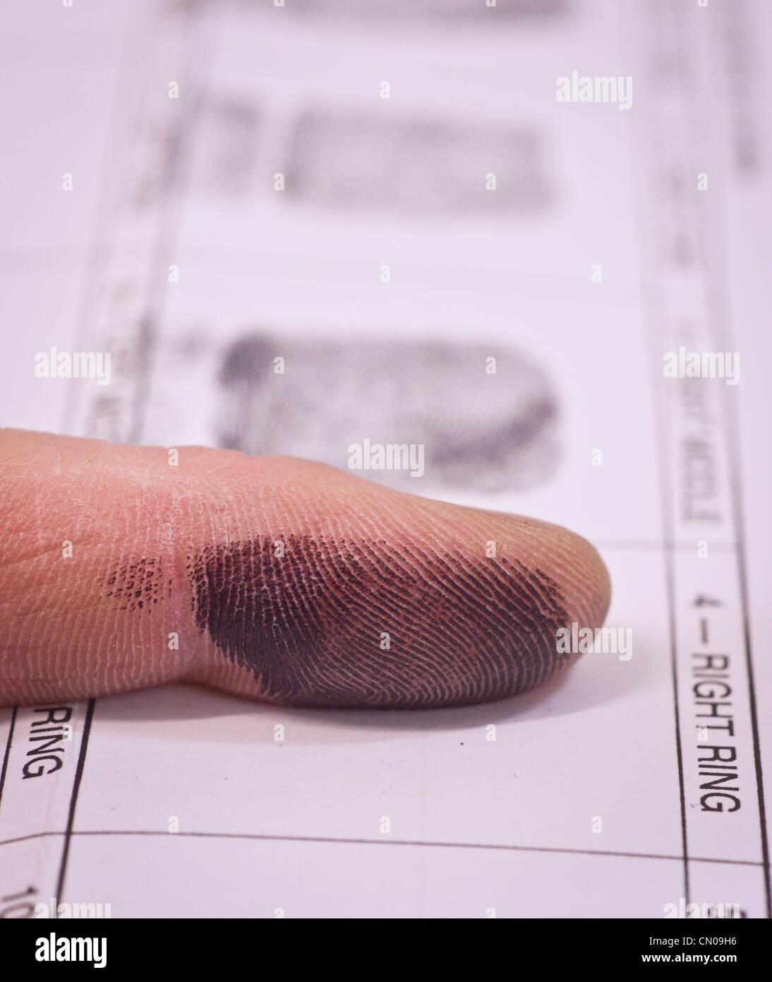 Une personne ayant pris ses empreintes digitales Photo Stock