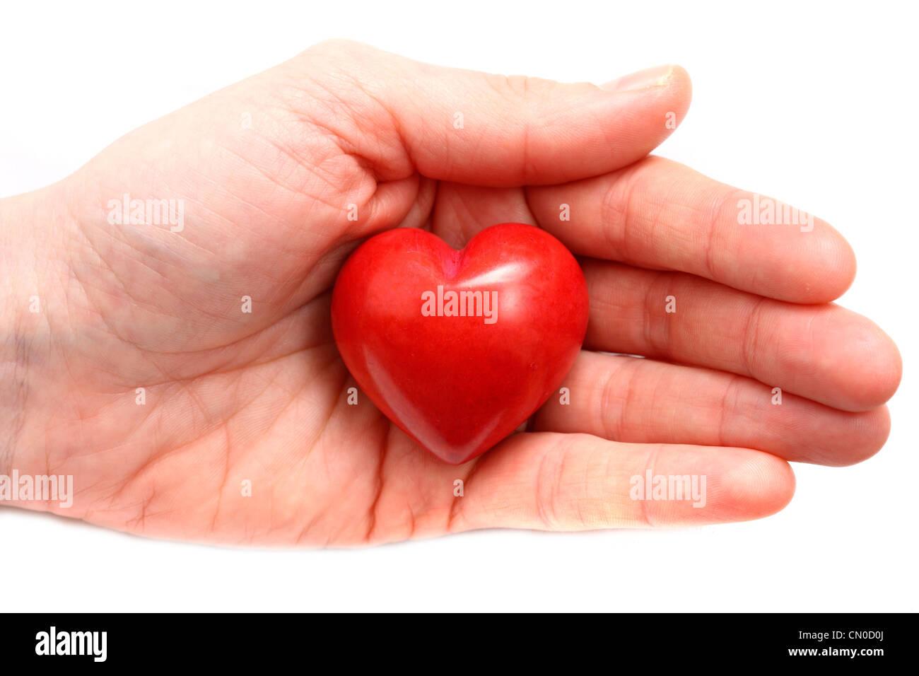 Image symbolique, la maladie cardiaque, crise cardiaque, la protection, la prévention, la cardiologie. Mains Photo Stock
