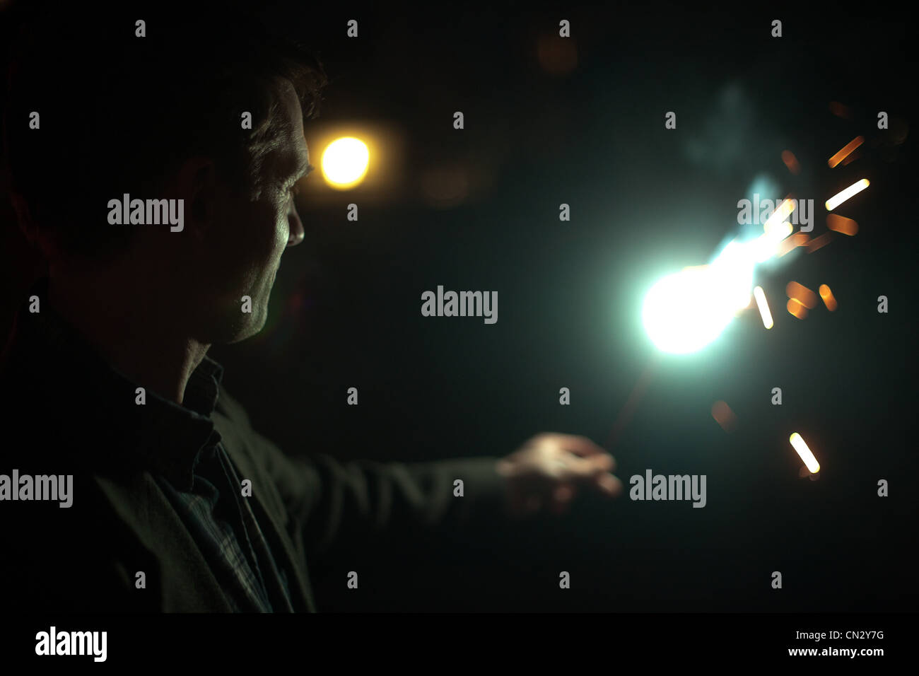 Man holding sparkler Photo Stock